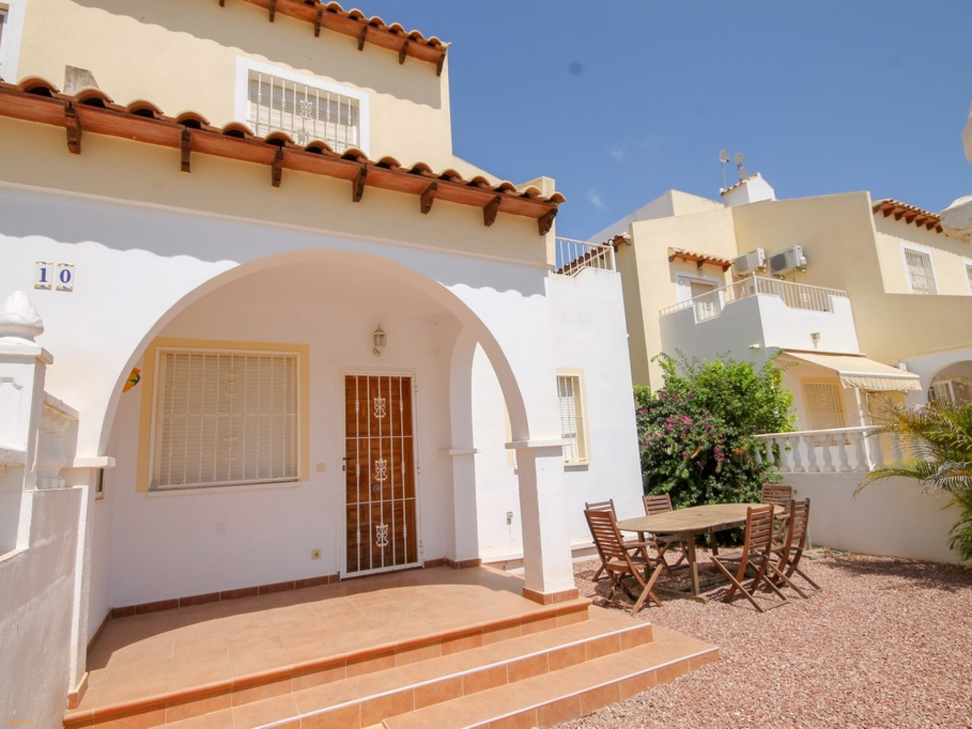 South facing quad villa with access to a communal pool